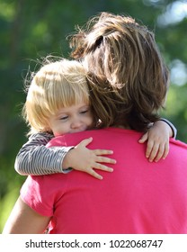 Cute young child hug her mom