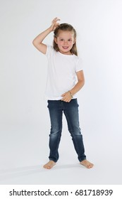Cute young child standing white background smiling