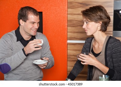 Cute young couple having fun over a cup of coffee and tea