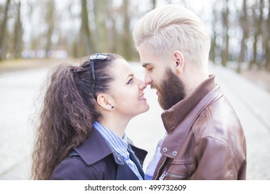 Cute young couple having kind loving moments.