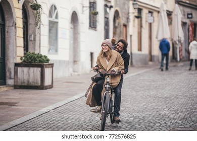 Cute young couple meeting in old city centre before Christmas