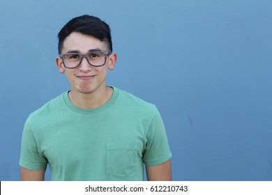 Cute young ethnic male with glasses