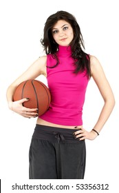 Cute young female in sports uniform holding the basketball