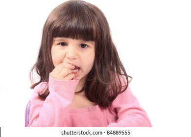 Cute young four year old child holding her tooth which may be loose or aching
