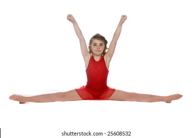 cute young girl doing a split with her arms above her head