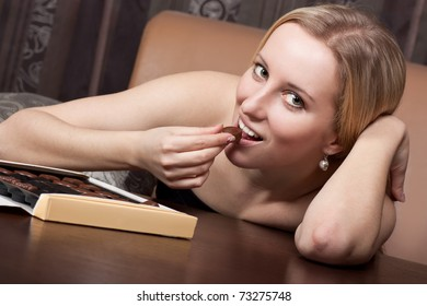 Cute young girl eating a candy