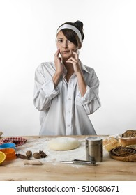 Cute young girl getting ready for baking cakes