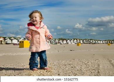 cute young girl having fun on the beach
