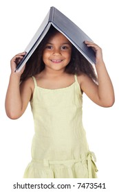 Cute young girl holding book on head