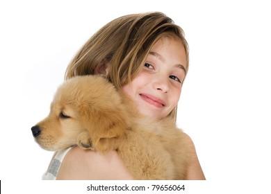 a cute young girl holding a Golden Retriever Puppy