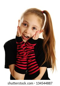 Cute young girl isolated on a white background, wearing pirate punk gloves with surprised face expression