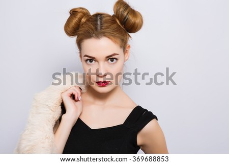 7a57e05c4d7e0 Cute young girl with light brown hair and red lips wearing black shirt and  holding white