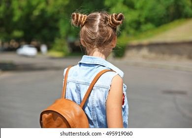 Cute young girl on street