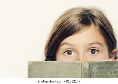 A cute young girl reading a book