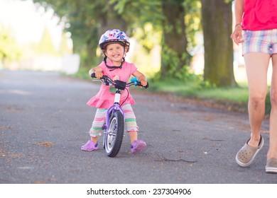 cute young girl riding a bike