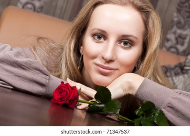 Cute young girl with a rose