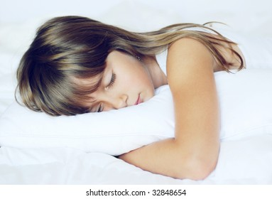 A cute young girl taking a nap