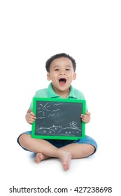 Cute young happy preschooler asian boy holding up black board for copy isolated on white
