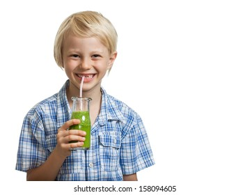 A cute young healthy boy drinking a green smoothie or juice through a straw. Isolated on white.