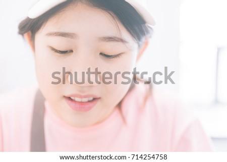 Delightful asian teen girl face close up seems me