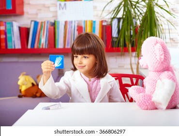 cute young kid playing a doctor in office