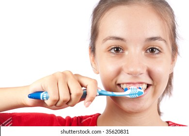 Cute young lady brushing her teeth, isolated on white