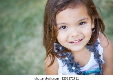 Cute Young Mixed Race Baby Girl Portrait Outdoors.