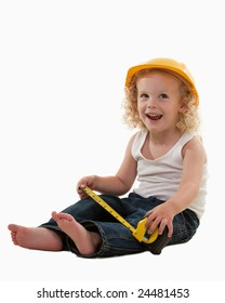 Cute young toddler with curly blond hair wearing construction worker hat, jeans and white tank top holding measuring tape over white smiling