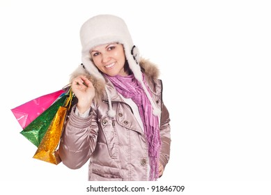 cute young woman with christmas gifts on white