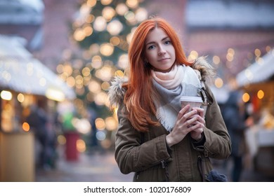 cute young woman at christmas market