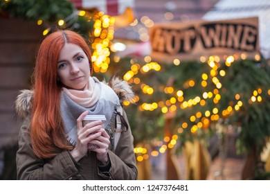 cute young woman at christmas market