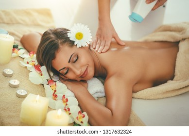 Cute young woman is enjoying during a skin care treatment at a spa.