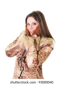 Cute young woman in fur coat portrait