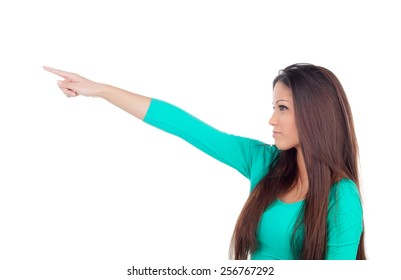 Cute young woman indicating something with the finger isolated on a white background