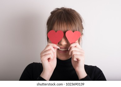 cute young woman in love with hearths in front of her face
