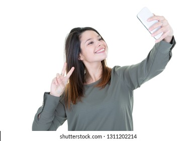 Cute young woman making selfie photo with phone smartphone