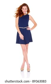 Cute young woman in navy blue dress on white background