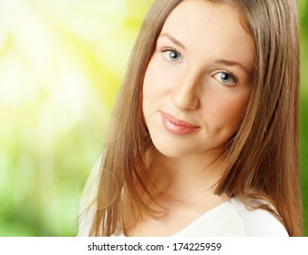 Cute young woman outdoors. Close-up portrait.