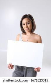 Cute young woman posing in studio
