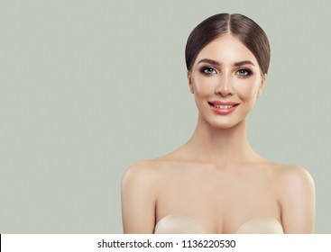 Cute Young Woman Smiling. Facial Treatment, Cosmetology, Beauty, Skin Care and Spa Portrait