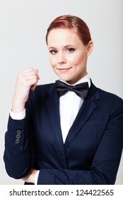 cute young woman in suit with bow tie