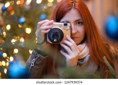 cute young woman taking picture