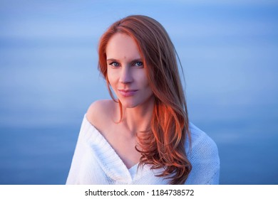 cute young woman walking on sea