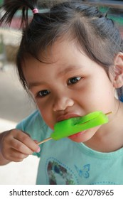 Cute,adorable asian little girl eating ice cream