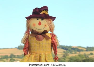 Cutestraw filled girl scarecrow on a farmland in East Devon