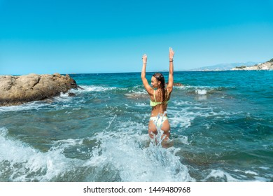 Cutie young girl having fun in sea summer time
