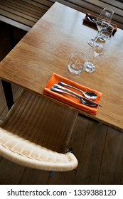 Cutlery and glasses on a wooden table