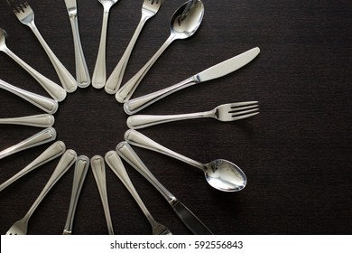 Cutlery on a black background. Fork, spoon, knife.