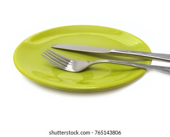 Cutlery on green plate