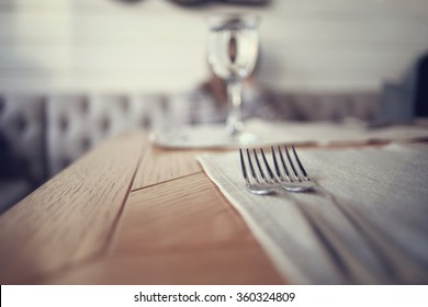 cutlery on the table in a restaurant table setting, knife, fork, spoon, interior